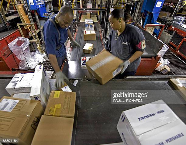 FedEx workers sort hundreds of boxes a minute inside the FedEx Memphis Tennessee Headquarters and World Hub on October 9 where the bulk of FedEx's US...
