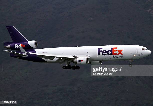 FedEx's 'Jim Riedmeyer' on arrival for runway 25L. The lush green of the Lantau mountains give a great contrast and frames the mighty MD-11 nicely.