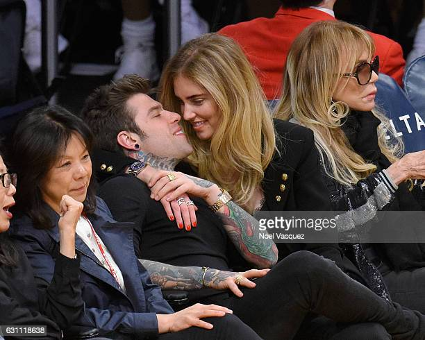 Fedez and Chiara Ferragni kiss at a basketball game between the Miami Heat and the Los Angeles Lakers at Staples Center on January 6 2017 in Los...