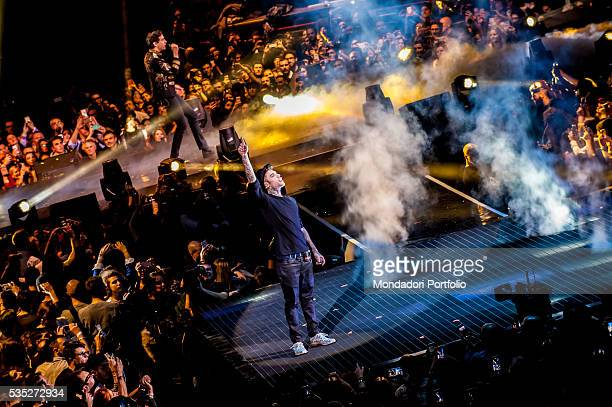 Fedez and Mika both artists and judges at X Factor performing on stage during the finale of the talent show at Mediolanum Forum Assago Italy 10th...