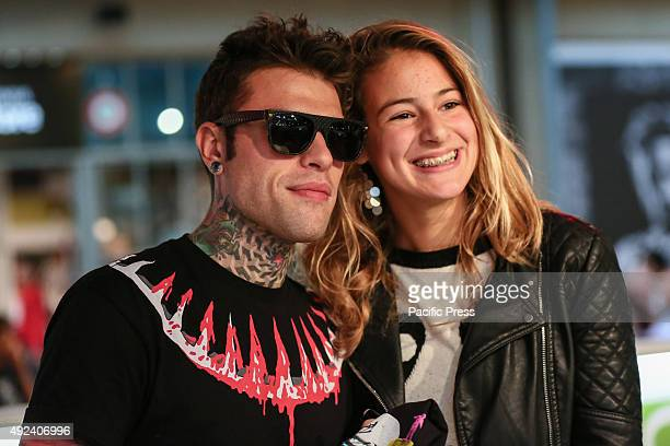 """Fedez poses for a picture with his fan. The Italian rapper Fedez has met hundreds of his fans to autograph the repack album """"Pop-Hoolista"""", titled..."""
