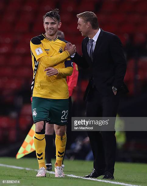 Fedor Cernych of Lithuania is congratulated on his goal by Lithuanias manager Edgaras Janauskas during the FIFA 2018 World Cup Qualifier between...