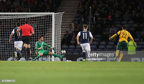 Fedor Cernych of Lithuania scores the opening goal during the FIFA 2018 World Cup Qualifier between Scotland and Lithuania at Hampden Park on October...