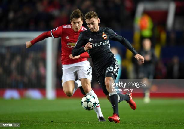 Fedor Chalov of CSKA Moscow and Victor Lindelof of Manchester United during the UEFA Champions League group A match between Manchester United and...