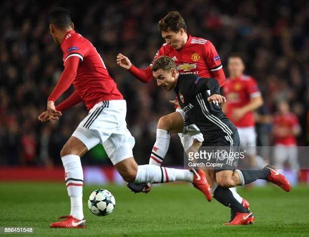 Fedor Chalov of CSKA Moscow is tackled by Victor Lindelof of Manchester United during the UEFA Champions League group A match between Manchester...