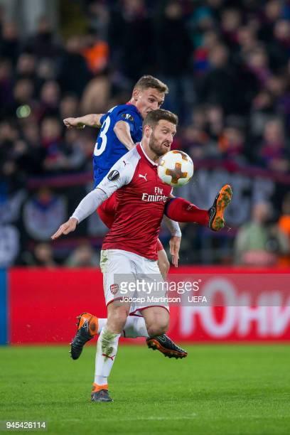 Fedor Chalov of CSKA Moskva competes with Shkodran Mustafi of Arsenal during the UEFA Europa League quarter final leg two match between CSKA Moskva...