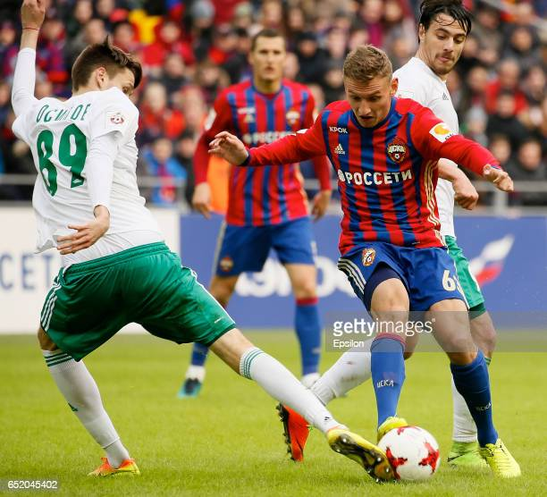 Fedor Chalov of PFC CSKA Moscow challenged by Dmitry Osipov of FC Tom Tomsk during the Russian Premier League match between PFC CSKA Moscow and FC...