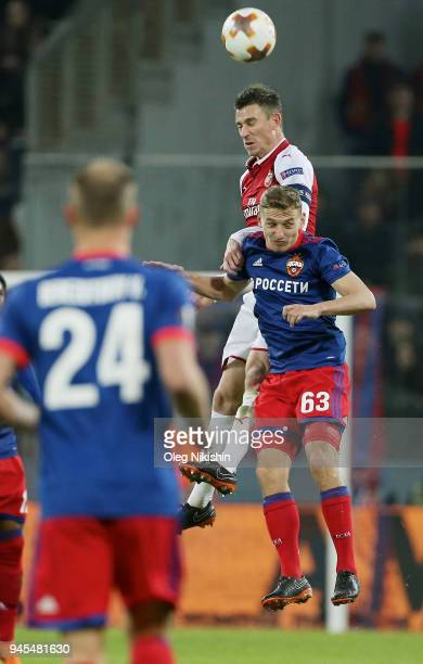 Fedor Chalov of PFC CSKA Moskva vies for the ball with Laurent Koscielny of Arsenal FC during the UEFA Europa League quarter final leg two match...