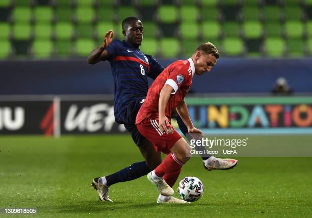 Fedor Chalov of Russia is closed down by Ibrahima Konate of France during the 2021 UEFA European Under-21 Championship Group C match between Russia...