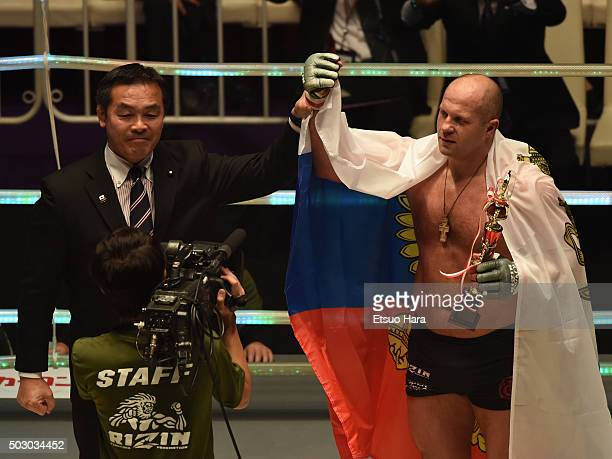 Fedor Emelianenko of Russia celebrates his victory with Hiroshi Hase the Minister of EducationCultureSportsScience and Technology Japan in the bout...