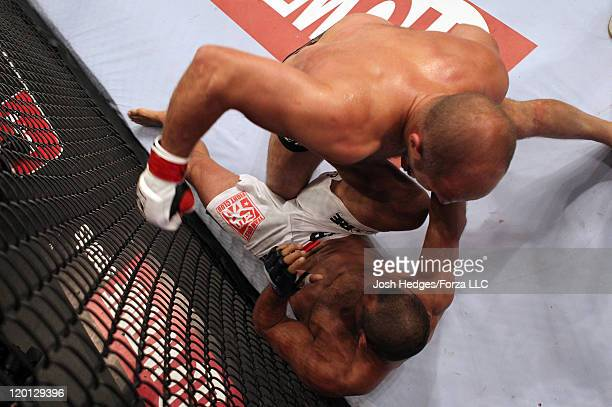 Fedor Emelianenko punches Dan Henderson during a heavyweight fight at the Strikeforce event at Sears Centre Arena on July 30 2011 in Hoffman Estates...
