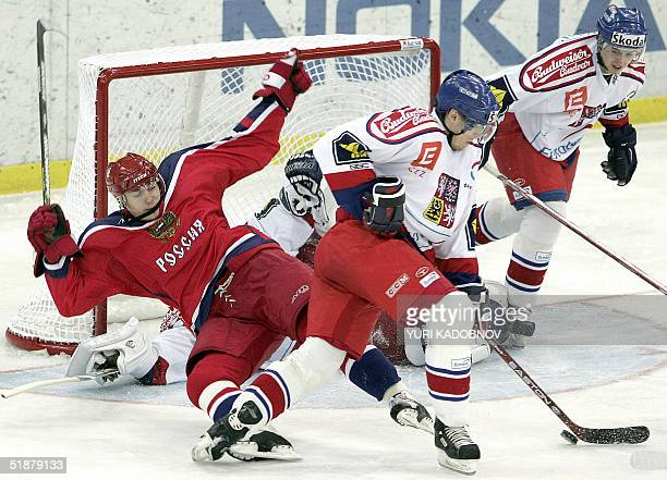 Fedor Fedorov of Russian team Michal Mikeska and Jaroslav Hlinka of Czech national team at ROSNO Cup ice hockey tournament in Moscow 19 December 2004...