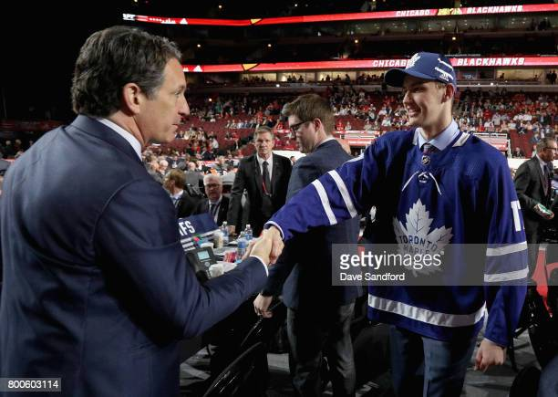 Fedor Gordeev meets president Brendan Shanahan after being selected 141st overall by the Toronto Maple Leafs during the 2017 NHL Draft at United...