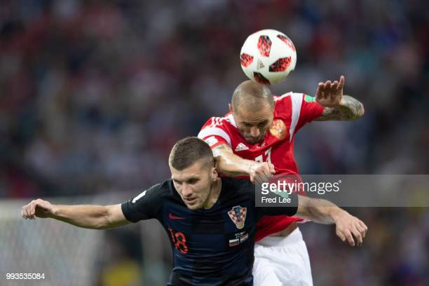 Fedor Kudriashov of Russia and Ante Rebic of Croatia in action during the 2018 FIFA World Cup Russia Quarter Final match between Russia and Croatia...