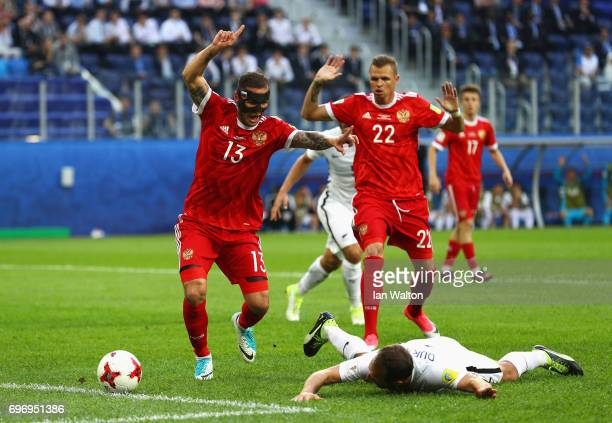 Fedor Kudriashov of Russia fouls Andrew Durante of New Zealand during the FIFA Confederations Cup Russia 2017 Group A match between Russia and New...