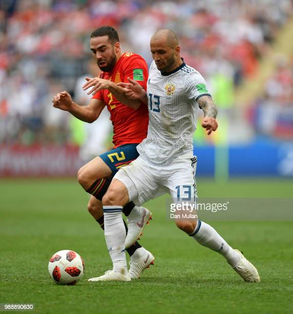 Fedor Kudriashov of Russia is challenged by Dani Carvajal of Spain during the 2018 FIFA World Cup Russia Round of 16 match between Spain and Russia...