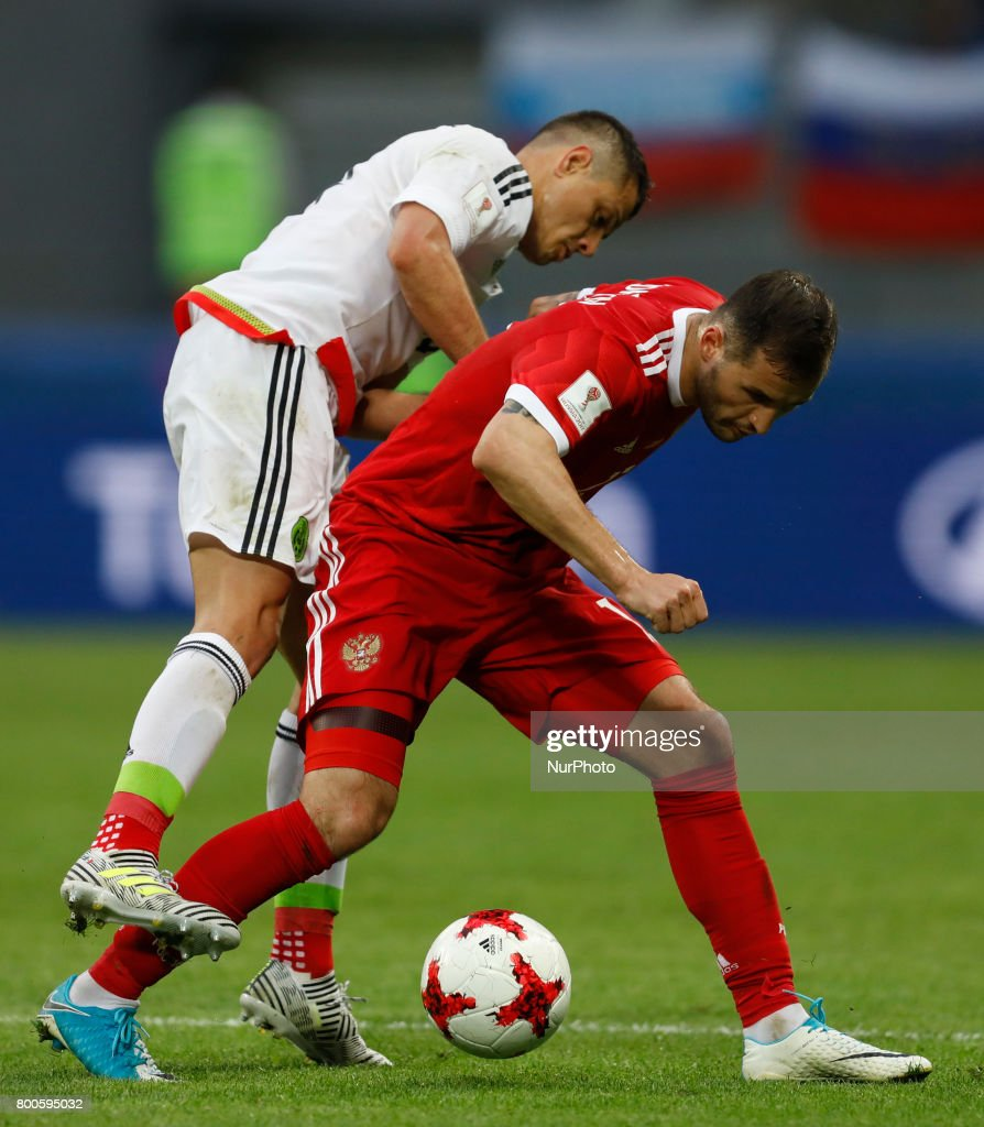 Fedor Kudriashov (R) of Russia national team and Javier Hernandez of Mexico national team vie for the ball during the Group A - FIFA Confederations Cup Russia 2017 match between Russia and Mexico at Kazan Arena on June 24, 2017 in Kazan, Russia.