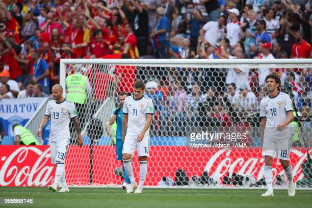Fedor Kudriashov Roman Zobnin and Yury Zhirkov of Russia look dejected after Sergey Ignashevich of Russia scored an own goal to make it 10 during the...