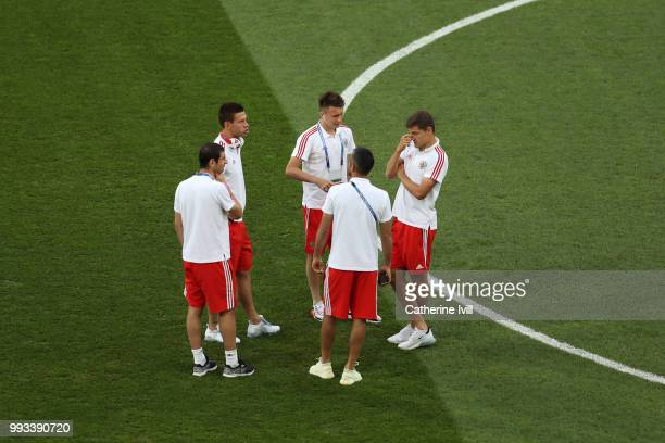 Fedor Smolov Aleksandr Golovin Alexandr Samedov Roman Zobnin and Alan Dzagoev of Russia talk during pitch ispection prior to the 2018 FIFA World Cup...