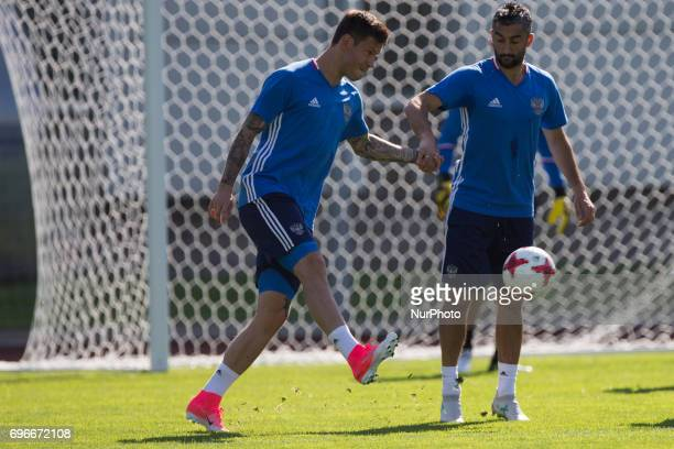 Fedor Smolov and Alexander Samedov of the Russian national football team at a training session ahead of their 2017 FIFA Confederations Cup match...