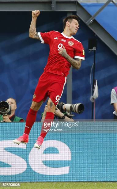 Fedor Smolov celebrates after scoring the second goal in Russia's 20 win over New Zealand in the Confederations Cup opening match at Saint Petersburg...