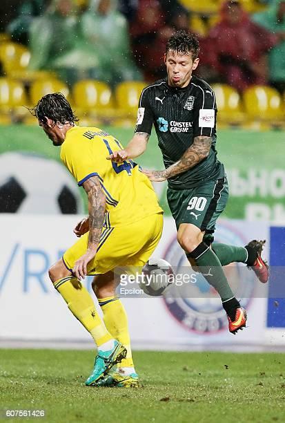 Fedor Smolov of FC Krasnodar is challenged by Cesar Navas of FC Rostov during the Russian Premier League match between FC Krasnodar v FC Rostov at...