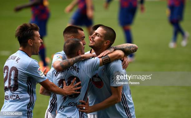Fedor Smolov of RC Celta Vigo celebrates scoring his sides first goal during the Liga match between RC Celta de Vigo and FC Barcelona at...