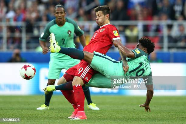 Fedor Smolov of Russia and Eliseu of Portugal battle for possessin during the FIFA Confederations Cup Russia 2017 Group A match between Russia and...