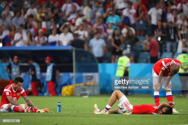 Fedor Smolov of Russia and his teammates looks dejected after losing in a penalty shootout during the 2018 FIFA World Cup Russia Quarter Final match...