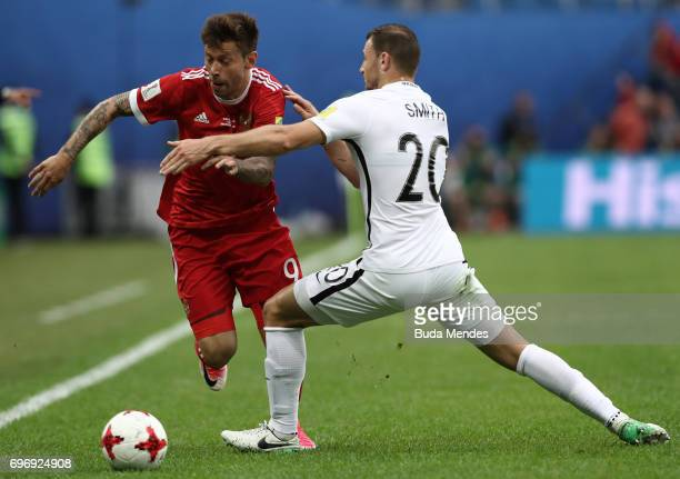 Fedor Smolov of Russia attempts to get past Tommy Smith of New Zealand during the FIFA Confederations Cup Russia 2017 Group A match between Russia...