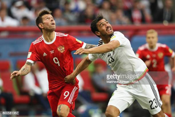 Fedor Smolov of Russia competes with Oswaldo Alanis of Mexico during the FIFA Confederations Cup Russia 2017 Group A match between Mexico and Russia...
