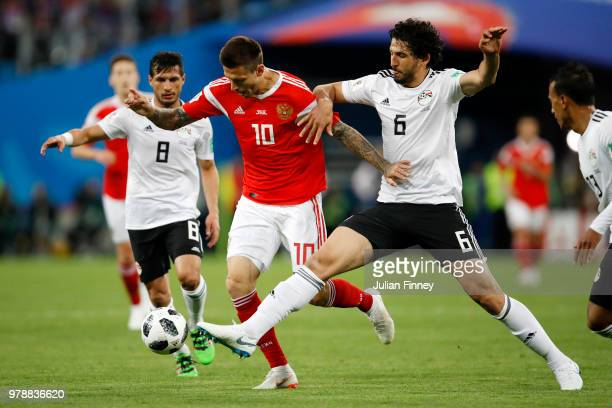 Fedor Smolov of Russia is challenged by Ahmed Hegazy and Tarek Hamed of Egypt during the 2018 FIFA World Cup Russia group A match between Russia and...