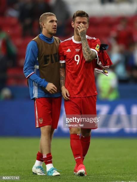 Fedor Smolov of Russia is consoled by Dmitry Kombarov after the FIFA Confederations Cup Russia 2017 Group A match between Mexico and Russia at Kazan...