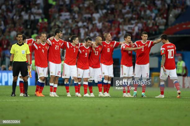 Fedor Smolov of Russia is consoled by teammates as they look on from the half way line during the penalty shoot out during the 2018 FIFA World Cup...