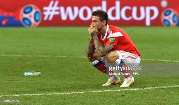 Fedor Smolov of Russia looks dejected follwing his team's defeat in the 2018 FIFA World Cup Russia Quarter Final match between Russia and Croatia at...