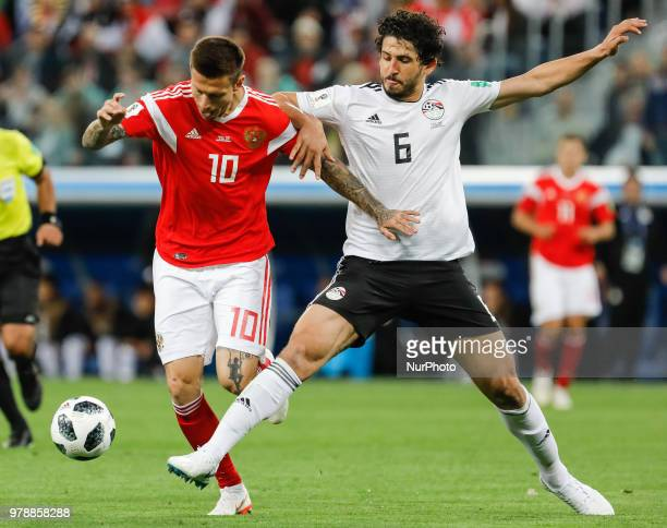 Fedor Smolov of Russia national team and Ahmed Hegazy of Egypt national team vie for the ball during the 2018 FIFA World Cup Russia group A match...