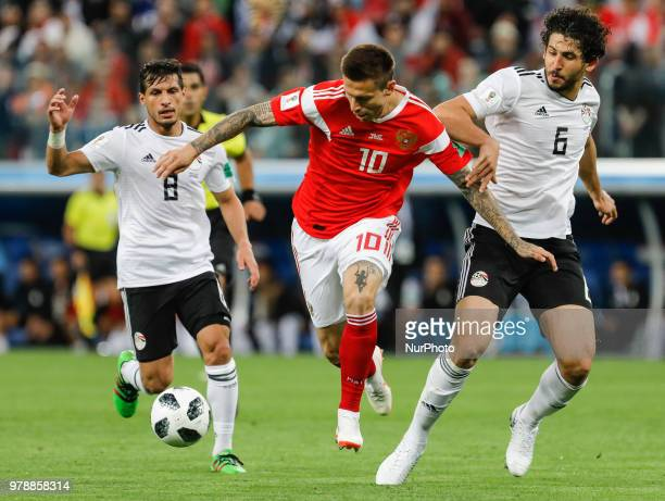 Fedor Smolov of Russia national team vies for the ball with Tarek Hamed and Ahmed Hegazy of Egypt national team during the 2018 FIFA World Cup Russia...