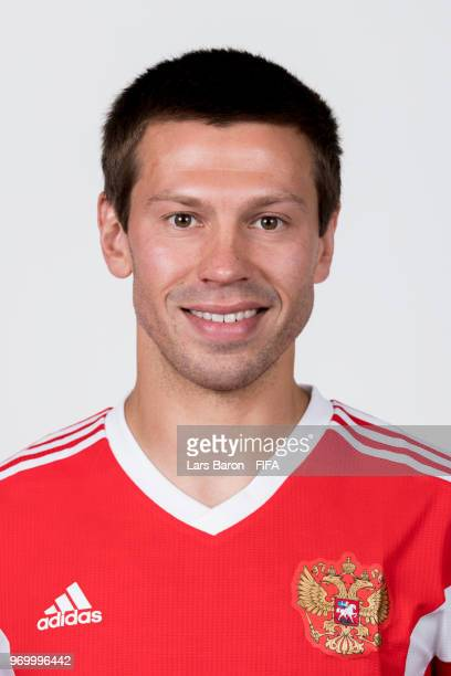Fedor Smolov of Russia poses for a portrait during the official FIFA World Cup 2018 portrait session at Federal Sports Centre Novogorsk on June 8...