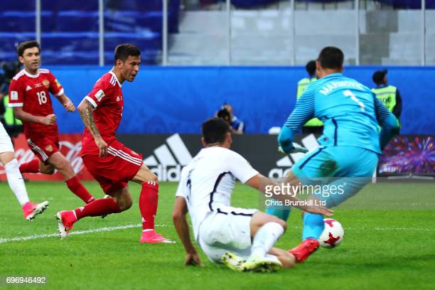 Fedor Smolov of Russia scores his side's second goal during the FIFA Confederations Cup Group A match between Russia and New Zealand at Saint...