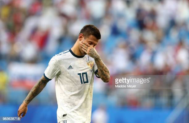 Fedor Smolov of Russia walks off dejected following the 2018 FIFA World Cup Russia group A match between Uruguay and Russia at Samara Arena on June...