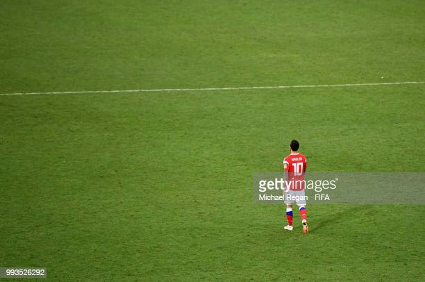 Fedor Smolov of Russia walks off the pitch dejected follwing his team's defeat in the 2018 FIFA World Cup Russia Quarter Final match between Russia...