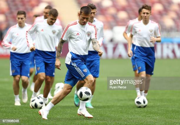 Fedor Smolov of Russia warms up with team mates during a Russia training session ahead of the 2018 FIFA World Cup opening match against Saudia Arabia...