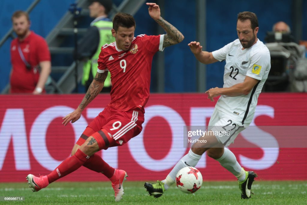 Fedor Smolov (L) of the Russian national football team and Andrew Durante of the New Zealand national football team vie for the ball during the 2017 FIFA Confederations Cup match, first stage - Group A between Russia and New Zealand at Saint Petersburg Stadium on June 17, 2017 in St. Petersburg, Russia.