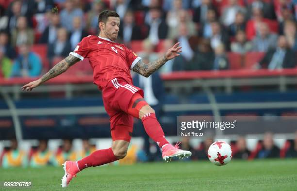 Fedor Smolov of the Russian national football team vie for the ball during the 2017 FIFA Confederations Cup match first stage Group A between Russia...