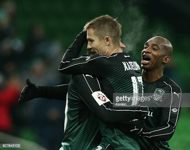 Fedor Smolov Vitali Kaleshin and Charles Kabore of FC Krasnodar celebrate after scoring a goal during the Russian Premier League match between FC...