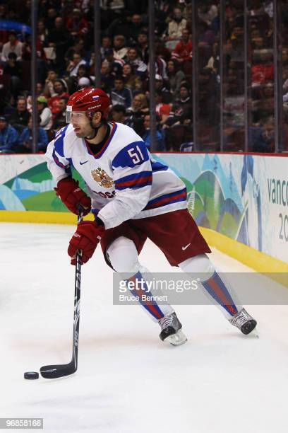 Fedor Tyutin of Russia skates with the puck during the ice hockey men's preliminary game between Slovakia and Russia on day 7 of the 2010 Winter...