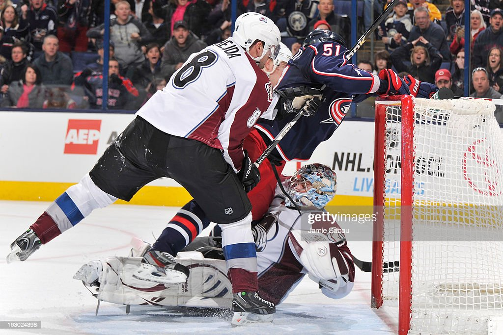 Fedor Tyutin #51 of the Columbus Blue Jackets is pushed on to goaltender Semyon Varlamov #1 of the Colorado Avalanche by Jan Hejda #8 of the Colorado Avalanche in the third period on March 3, 2013 at Nationwide Arena in Columbus, Ohio. Columbus defeated Colorado 2-1 in overtime.