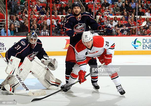 Fedor Tyutin of the Columbus Blue Jacks nudges Riley Nash from the top of the crease as Nash waits for a centering pass in front of Curtis McElhinney...