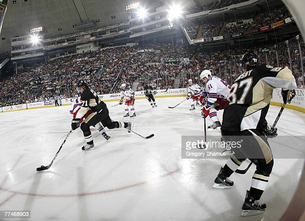 Fedor Tyutin of the New York Rangers can't defend a backhand pass from Sidney Crosby of the Pittsburgh Penguins to Evgeni Malkin on October 23 2007...