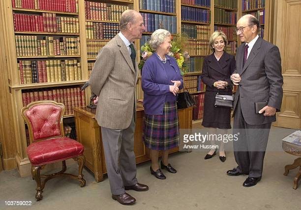 US Fedreral Reserve Chairman Alan Greenspan collects his honorary knighthood from the Queen with his wife Andrea Mitchell at his side and the Duke of...